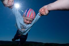 Adult Flying Young Child Stock Photo