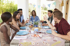 Adult friends at a dinner party on a patio, guest�s view Stock Photos