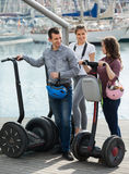 Adult friends with segways near sea Royalty Free Stock Photos
