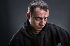 Adult frowning man Royalty Free Stock Photo