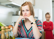 Adult frustrated mom scolding little daughter Royalty Free Stock Photo