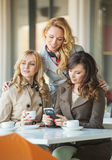 Adult girfriends in the coffee shop Royalty Free Stock Photography