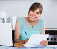 Adult girl applying for bank loan at home Royalty Free Stock Photo