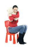 Adult girl hugging teddybear Royalty Free Stock Photos