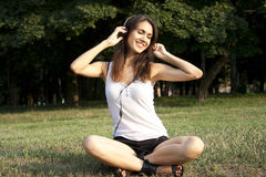 Adult girl listening to the music Royalty Free Stock Photography