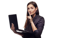 Adult girl with notebook saying shh stock photo