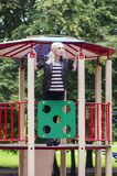 Adult girl on the playground Stock Photography