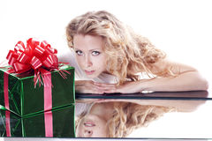 Adult girl with a present gift for New Year or Chr Stock Image