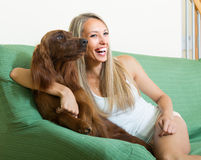 Adult girl with red Irish setter Royalty Free Stock Images