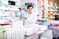 Adult girl is showing right drug Stock Photo