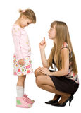 Adult girl swearing little girl Royalty Free Stock Image