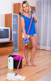 Adult girl washing floors at home Stock Images