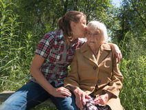Adult granddaughter grandmother kisses Stock Images