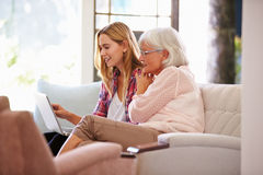 Adult Granddaughter Helping Grandmother With Computer Stock Photo