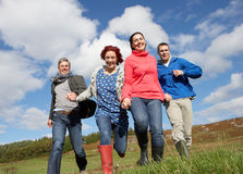 Adult group in countryside Royalty Free Stock Image