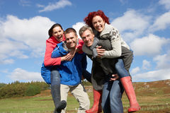Adult group in countryside Stock Images