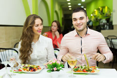 Adult guests resting and eating in  cafe Royalty Free Stock Photography