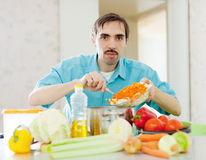 Adult guy cooking supper Royalty Free Stock Photo