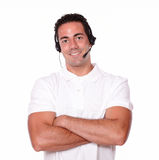 Adult guy with earphone crossing his arms Stock Photography