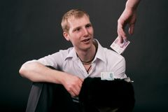 Adult guy give money. On black background Royalty Free Stock Photos