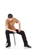 Adult guy sits on a isolate background Royalty Free Stock Images