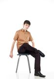 Adult guy sits on isolate backout. Portrait adult guy on isolate backout Royalty Free Stock Photo