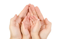 Adult hand hold kid's handful. Isolated on white background Royalty Free Stock Photography