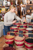 Adult happy woman buying dried beans Royalty Free Stock Image