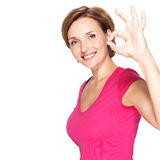 Adult happy woman with ok gesture. Portrait of a beautiful adult happy woman with ok gesture over white background Royalty Free Stock Images