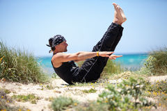Adult healthy man doing pilates yoga exercise Royalty Free Stock Images