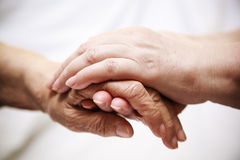 Adult helping senior in hospital Royalty Free Stock Images