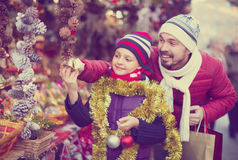 Adult with his small girl are looking for gifts Royalty Free Stock Images