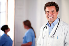 Adult hispanic doctor on white coat standing Royalty Free Stock Photo