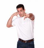 Adult hispanic guy with conversing gesture Stock Photography