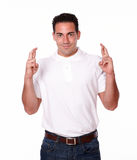 Adult hispanic guy with luck gesture Stock Image