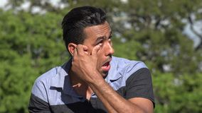 Adult Hispanic Man Allergic Irritation. A handsome adult hispanic man stock video footage