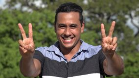 Adult Hispanic Man And Peace Gesture. A handsome adult hispanic man stock video