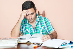 Adult hispanic man studying Stock Photography