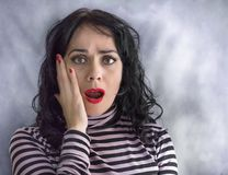 Adult hispanic woman over isolated background afraid and shocked with surprise expression royalty free stock photos