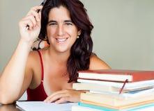 Adult hispanic woman studying Stock Photos