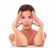 Adult hispanic woman touching her face Stock Photos