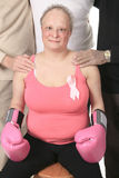 Adult holding a breast cancer logo Stock Photos