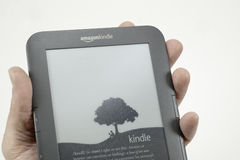 Adult holding kindle reader Stock Images