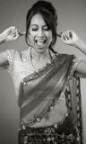 Adult indian woman in studio isolated on grey Stock Images