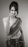 Adult indian woman in studio isolated on grey. Black and white model isolated on grey backround Stock Images
