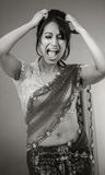 Adult indian woman in studio isolated on grey Royalty Free Stock Photography