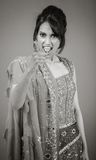 Adult indian woman in studio isolated on grey Stock Photo
