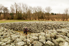 Adult lady in humid wether visiting a cairn Royalty Free Stock Photography