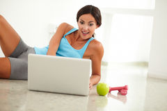 Adult lady laying and browsing the web Royalty Free Stock Photo
