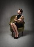 Adult lady sitting Stock Photo